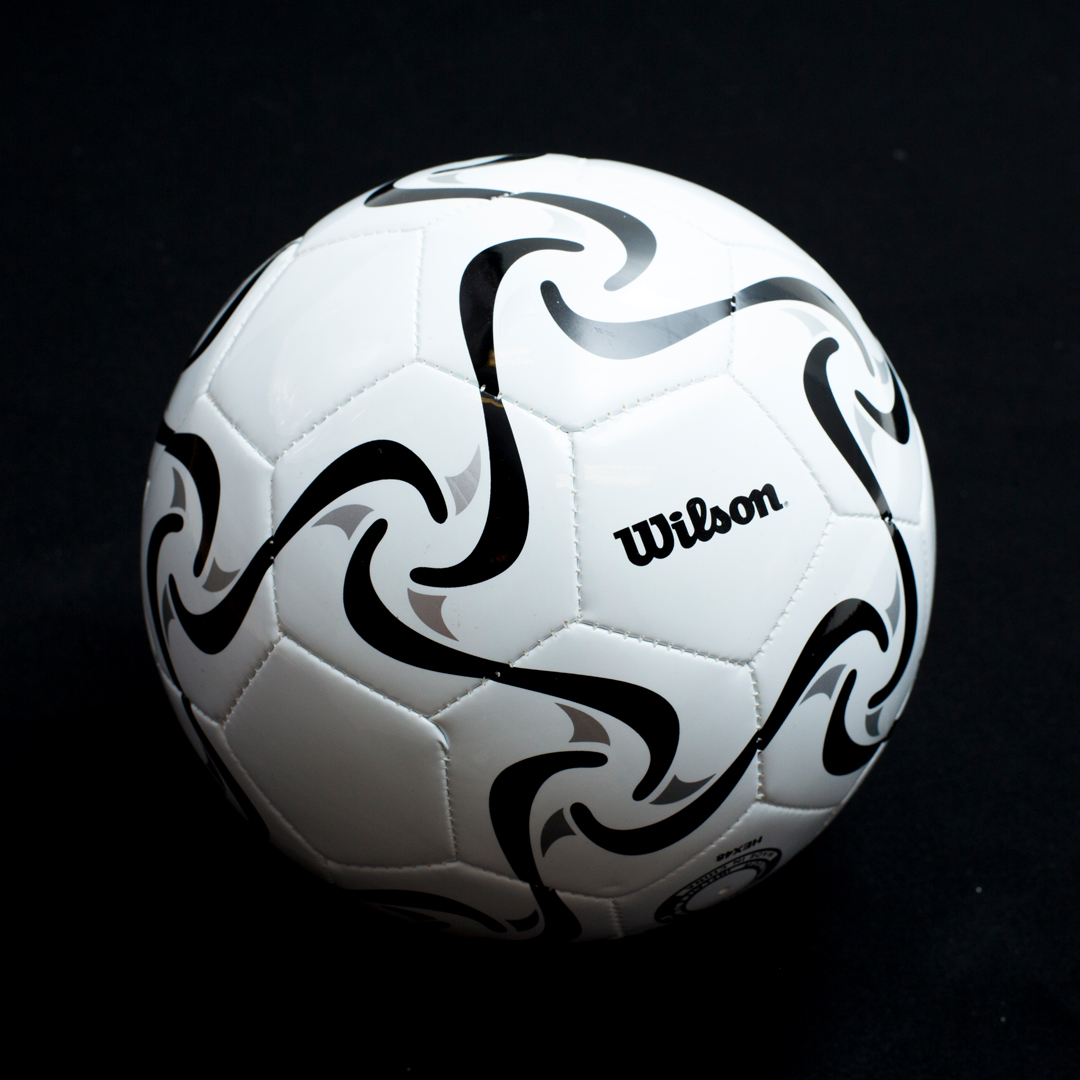 Wilson white soccer ball with a black pattern and rattles