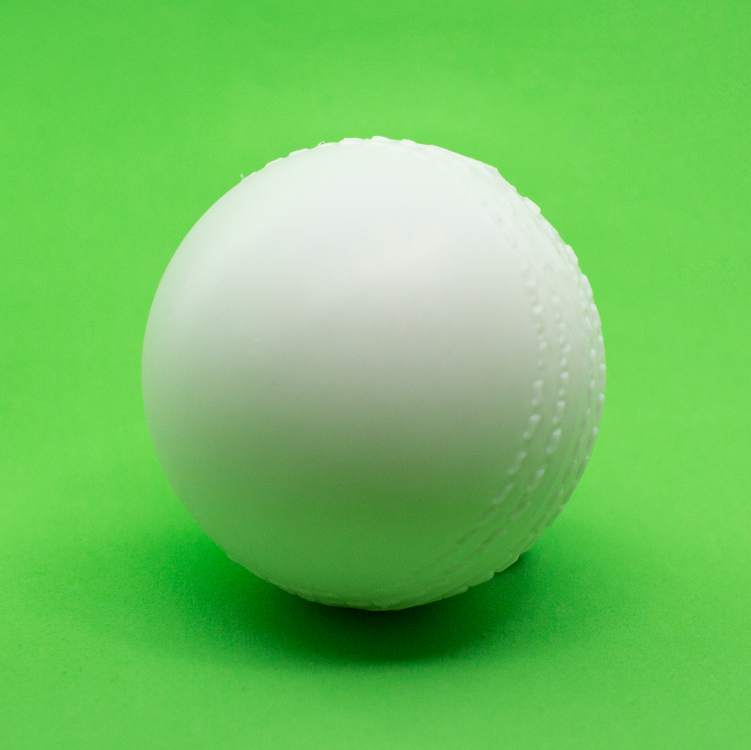 A white cricket ball with rattles