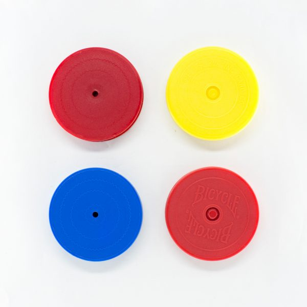 Four plastic playing card holders in red, yellow, and blue
