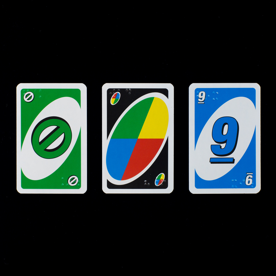 Three uno cards with braille lettering