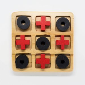 Wooden tic tac toe set with black noughts and red crosses