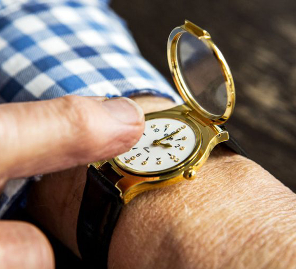 A man reading a tactile wrist watch