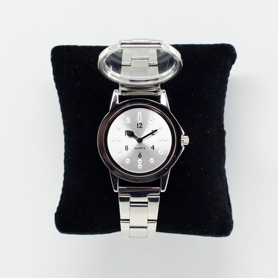 Silver tactile watch with a protective lid