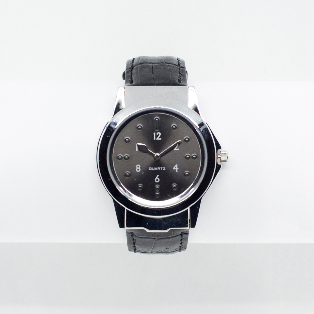 Tactile wrist watch with a leather strap and black face