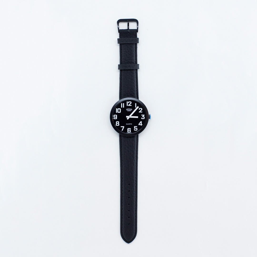 Jumbo sized low vision watch with black face and white numbers