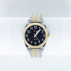 Chrome and gold watch with a black face and large print white numbers