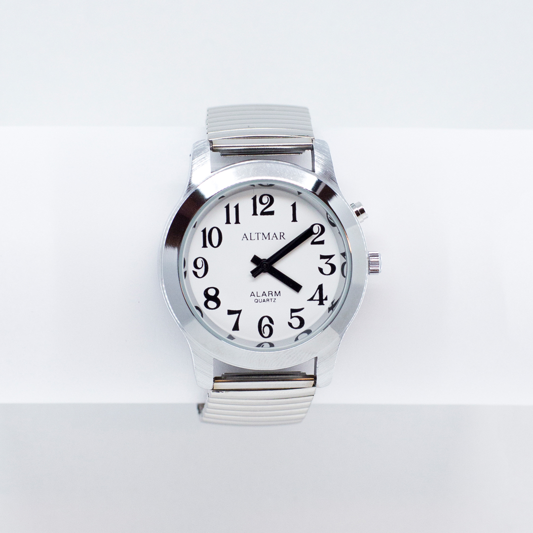 Large chrome talking watch with a white face and black numbers