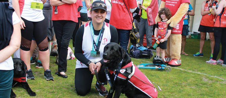 Ocean at the 2017 Auckland Marathon with her guide dog JJ