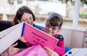 Laura reading with her mum