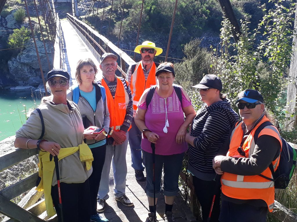 The Blind Mice walking group pose for a photo just before traversing Horseshoe Bend swing bridge.