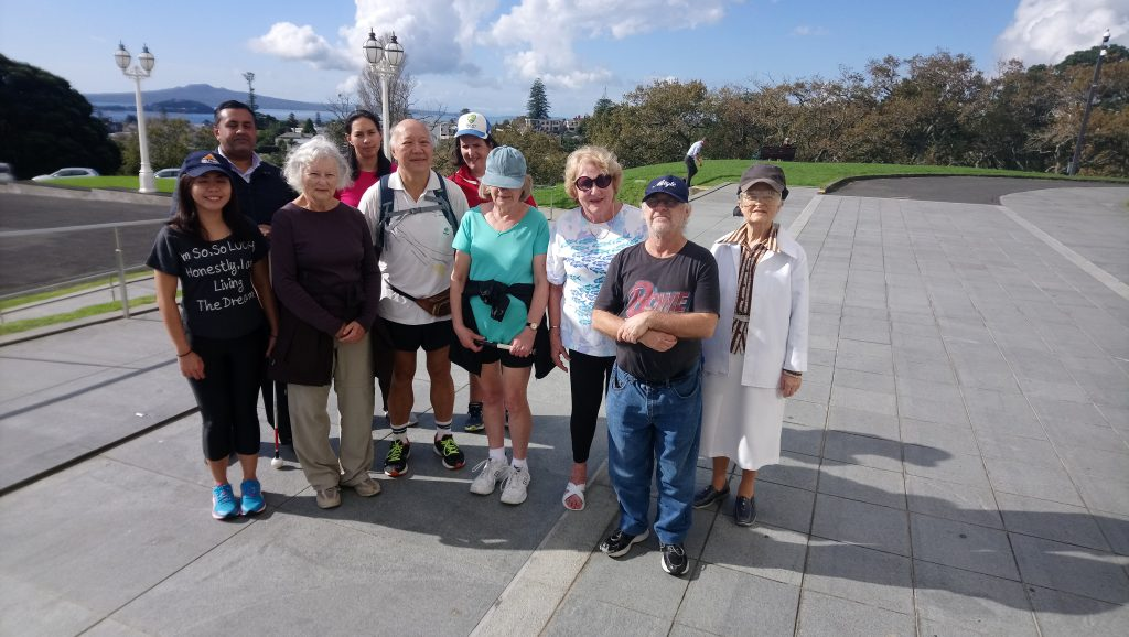 Members of the Amblers walking group stand outside in the Auckland Domain.