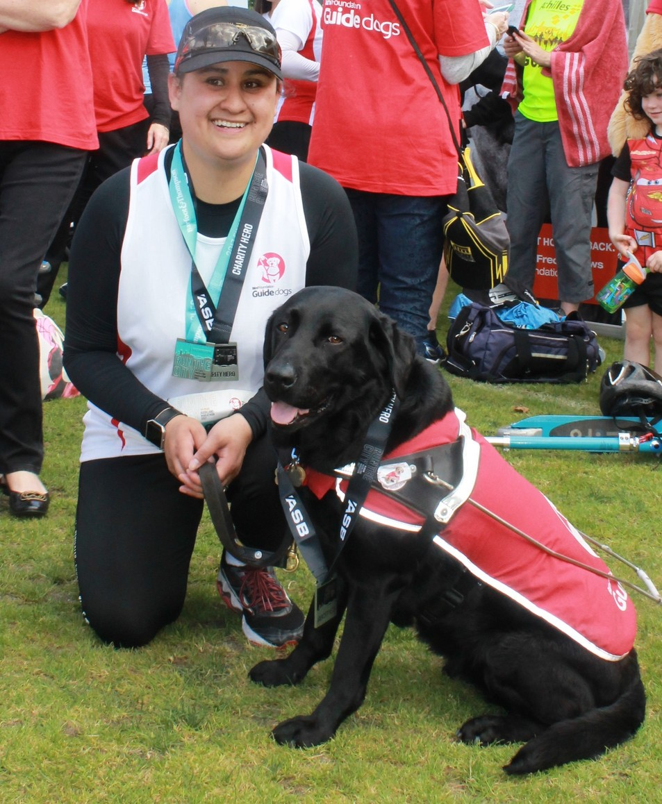 Ocean and her guide dog after the marathon 2017