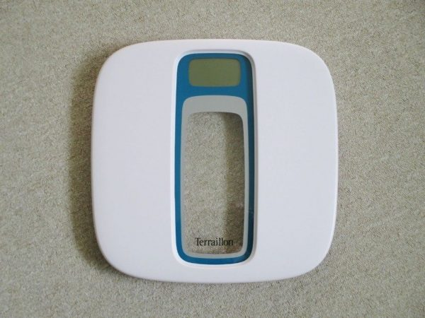 White talking bathroom scales with a clear panel in the middle