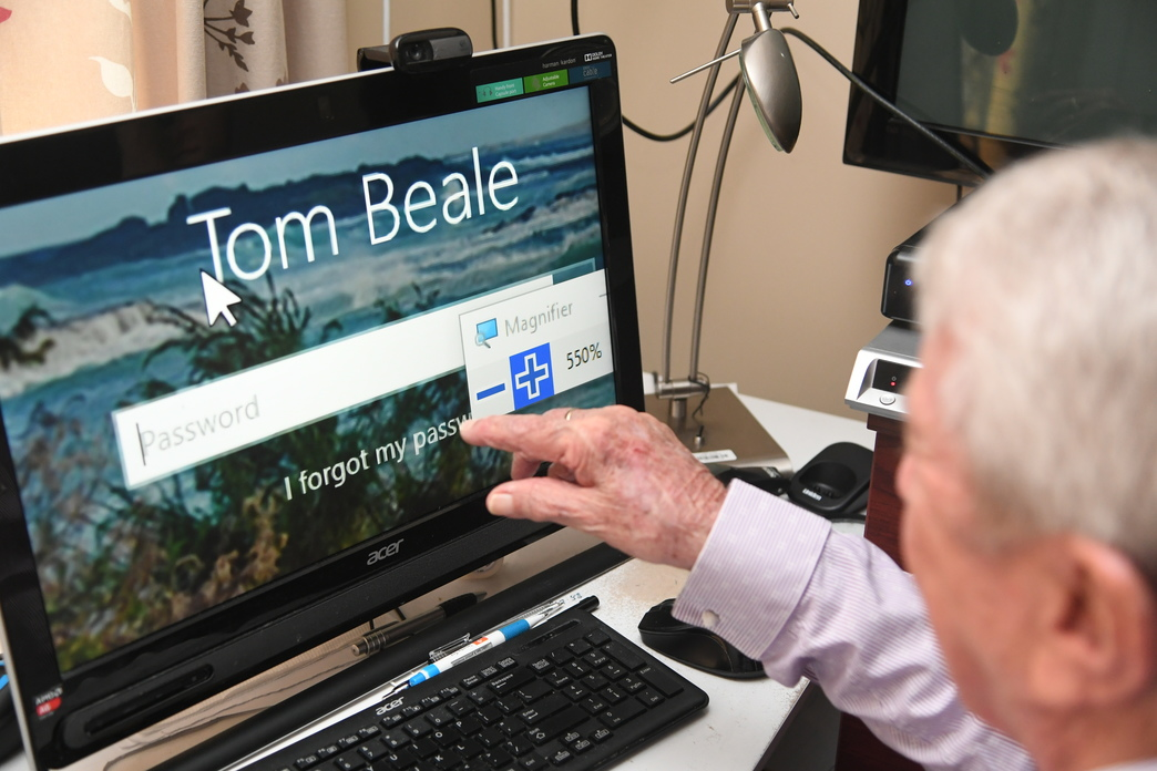 Tom Beale using the computer with a screen reader