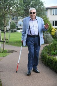 Tom walking with the cane