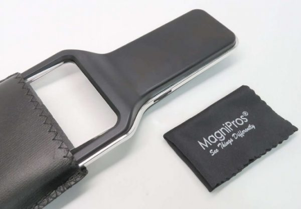 Image shows the dimmable LED 3x magnifier with the protective cover and cleaning cloth