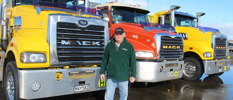 George stand with his trucks