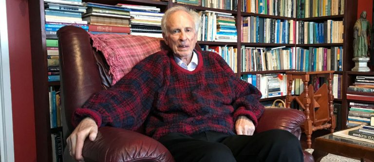 John Hinchcliff, in his office, surrounded by books