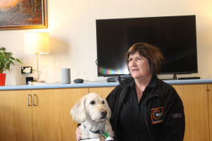 Joy McClintock and guide dog Molly at smart room opening