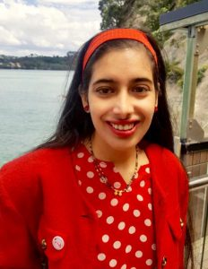 Ekta Kumar wears a red top with white dots and a matching headband.