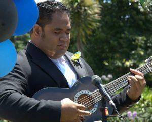 Ese Aumalesulu playing guitar.