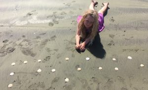 Phoebe wrote her name in braille using shells at Peka Peka beach in Wellington.