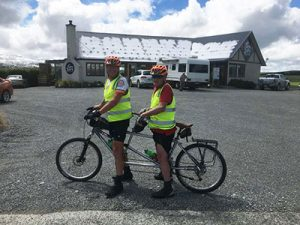 Volunteer Russel Shanks with Paul Glass on the tandem bike, Fairlie