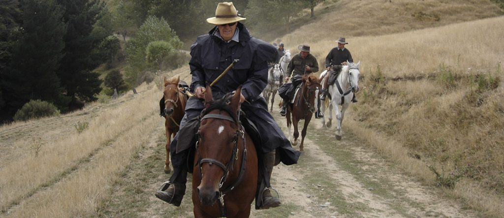 Dick Lancaster is riding on a horse