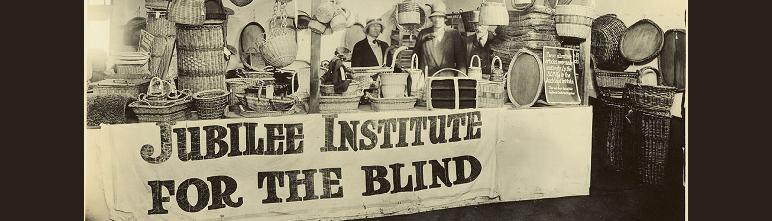 Black and white photo from the Blind Foundation Archive of a stall with goods produced by the Jubilee Institute For The Blind.