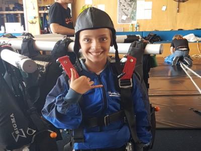 Nastacia posing in skydive gear