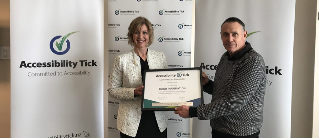 Tanya Colvin, Accessibility Tick Programme Lead presents Blind Foundation Acting Chief Executive Greg Hurn with the Accessibility Tick award.