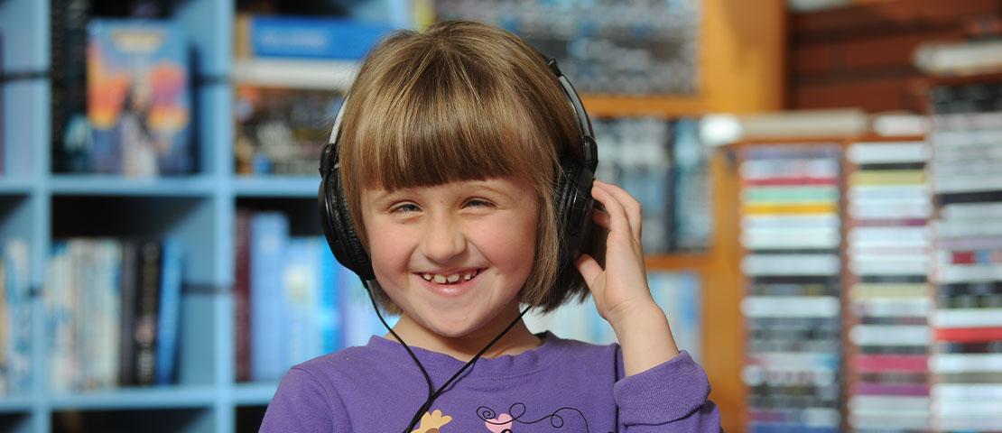 Brianna wearing talking books headphones