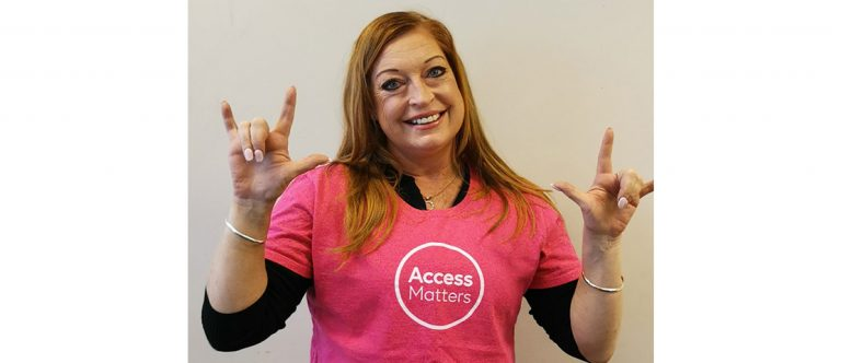 Taryn Banks wears an Access Alliance t-shirt and smiles