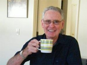 Ron Hainsworth relaxing with a hot drink.