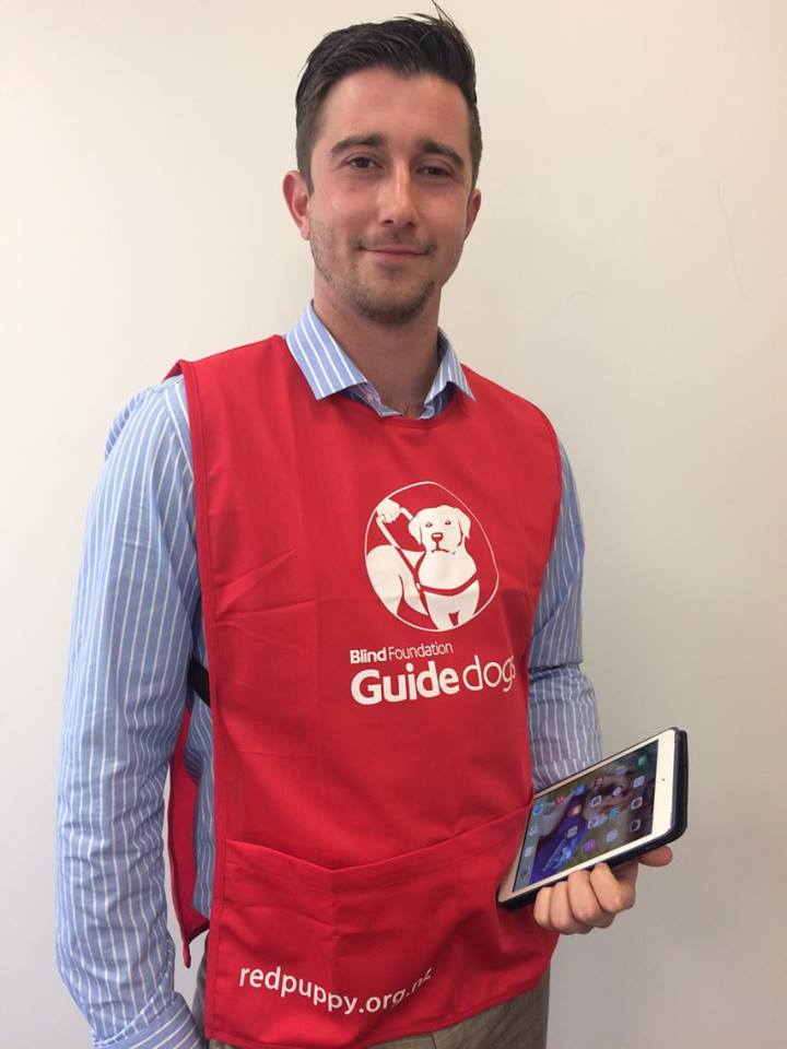 Face to Face fundraisier in red guide dogs bib