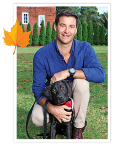 Neve sit on grass with Clarke Gayford
