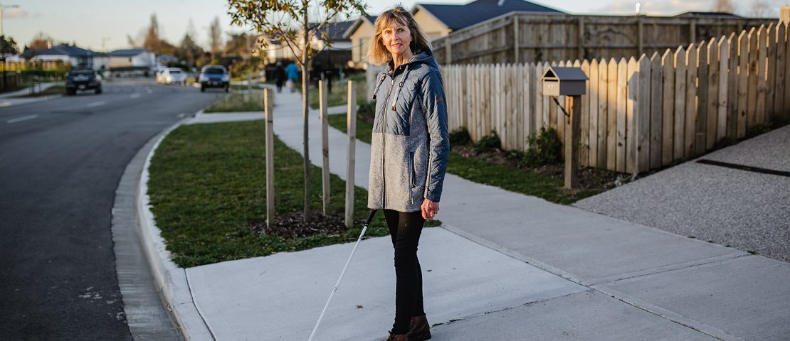 Sue walking using white cane