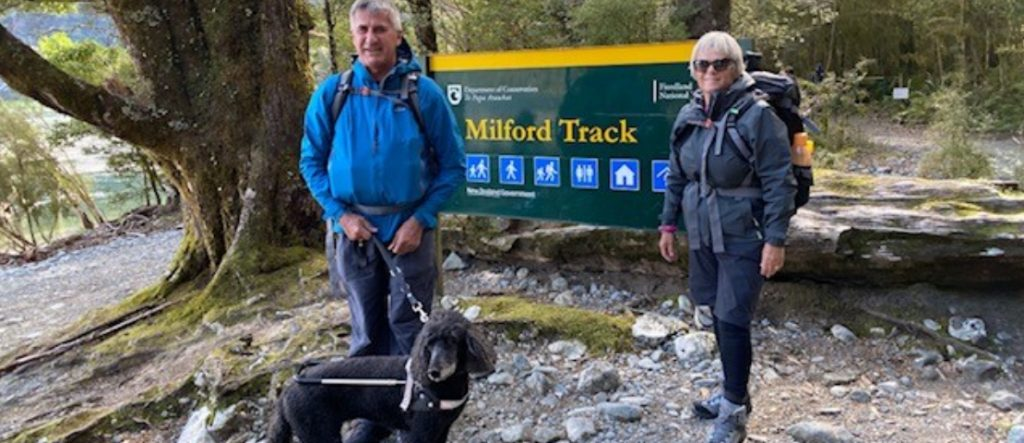 Neville, Jenny and guide dog Sophie at the start of the Milford Track