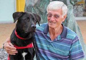 George Brock with a guide dog