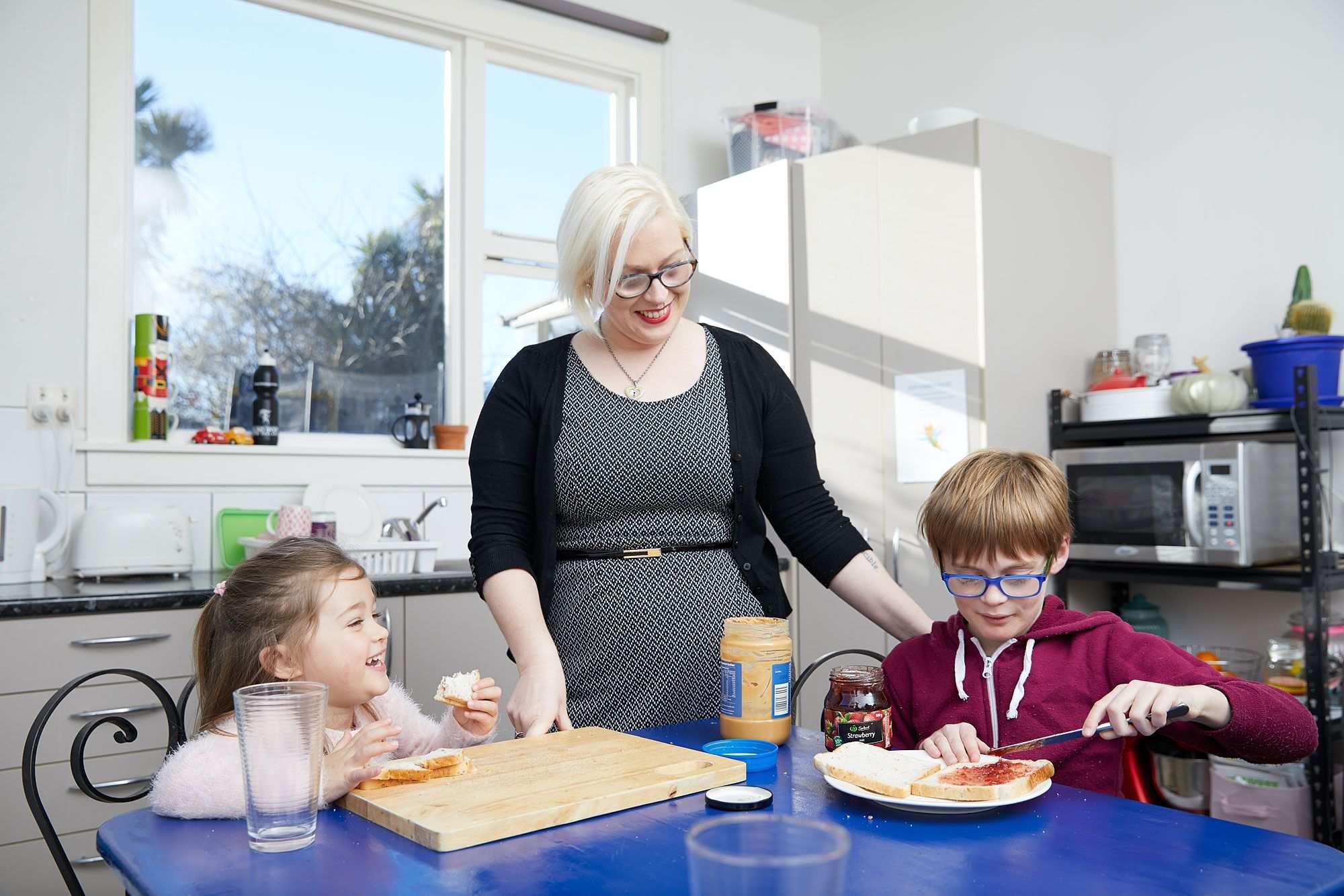 Loren prepares lunch with her children