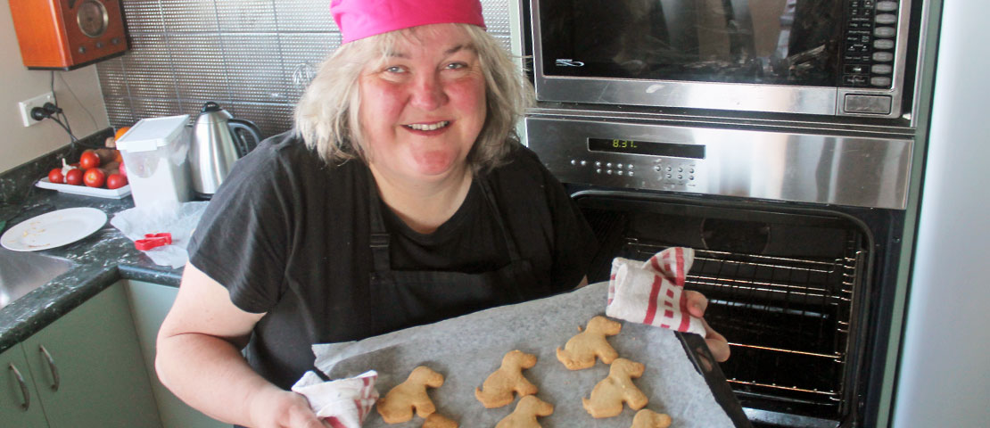 Julie Woods holding a tray of freshly baked biscuits