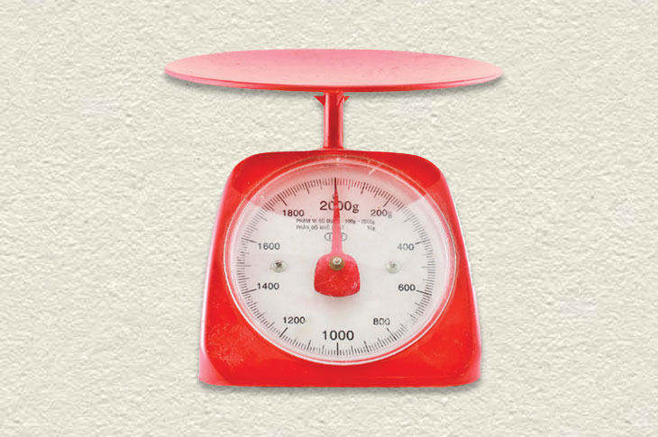 A red kitchen scale