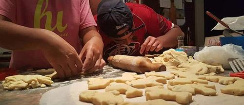 Tristan baking bikkies